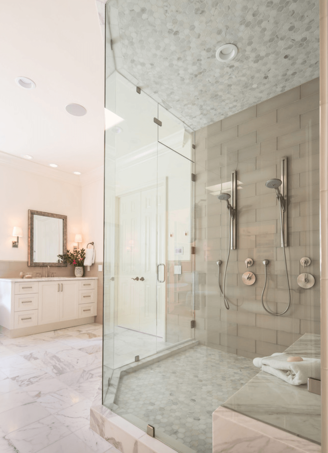 Cream and white Ceramic and porcelain tile in this contemporary master bathroom