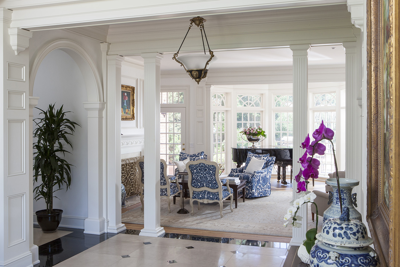 traditional home entry way with white and black and blue color palette