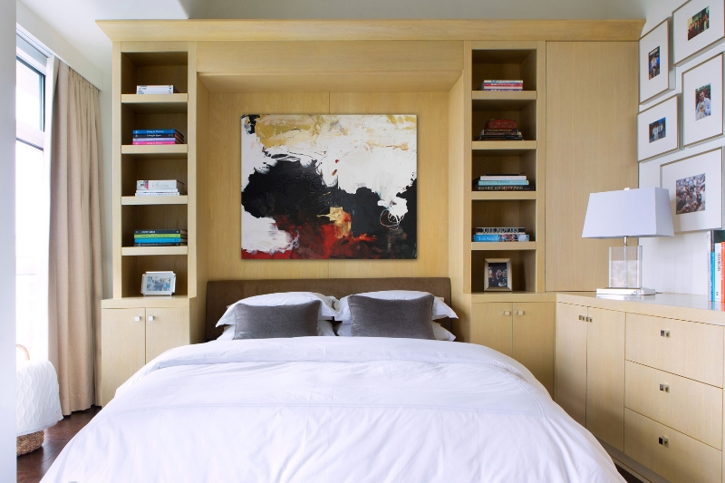 Built in Storage and abstract art in modern bedroom