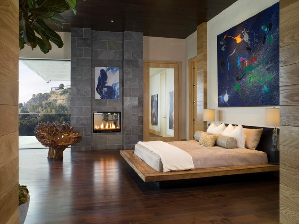 fireplace and abstract art in Los Angeles master bedroom