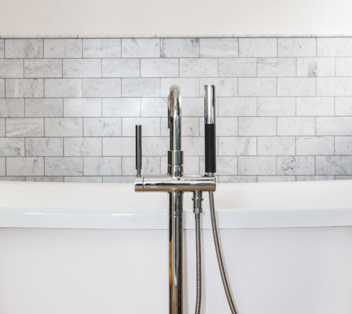 Conventional wisdom would have you believe your backsplash has to run up the entire wall, but that's just not so. Having a backsplash just a few inches above where the counter meets the wall is a great way to save money on materials, but still make a stylish and functional statement.