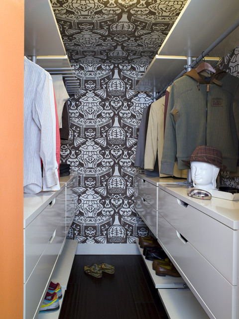 wallpapered modern walk-in closet