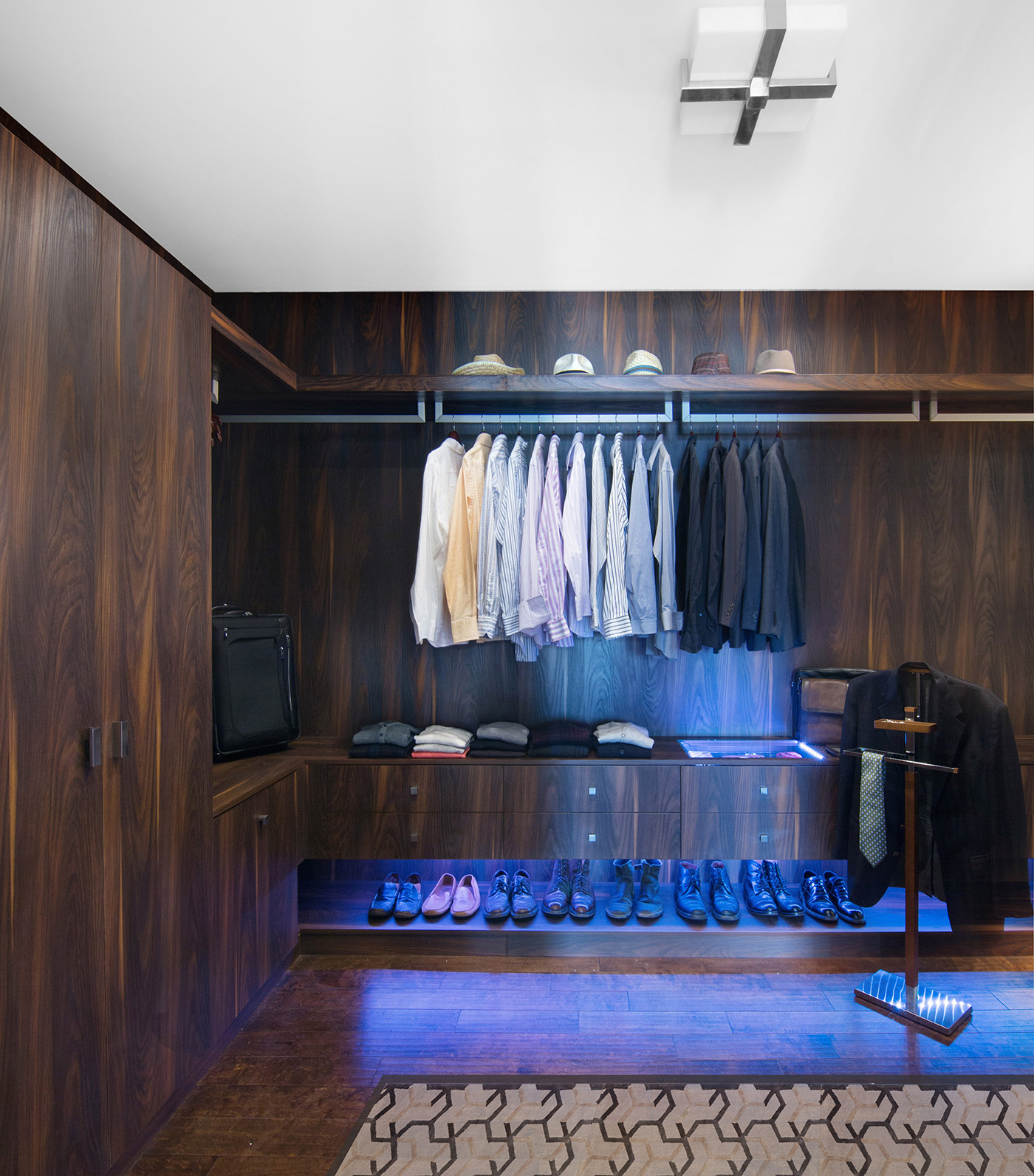 Men's walk in closet design idea by celebrity designer Lori Dennis