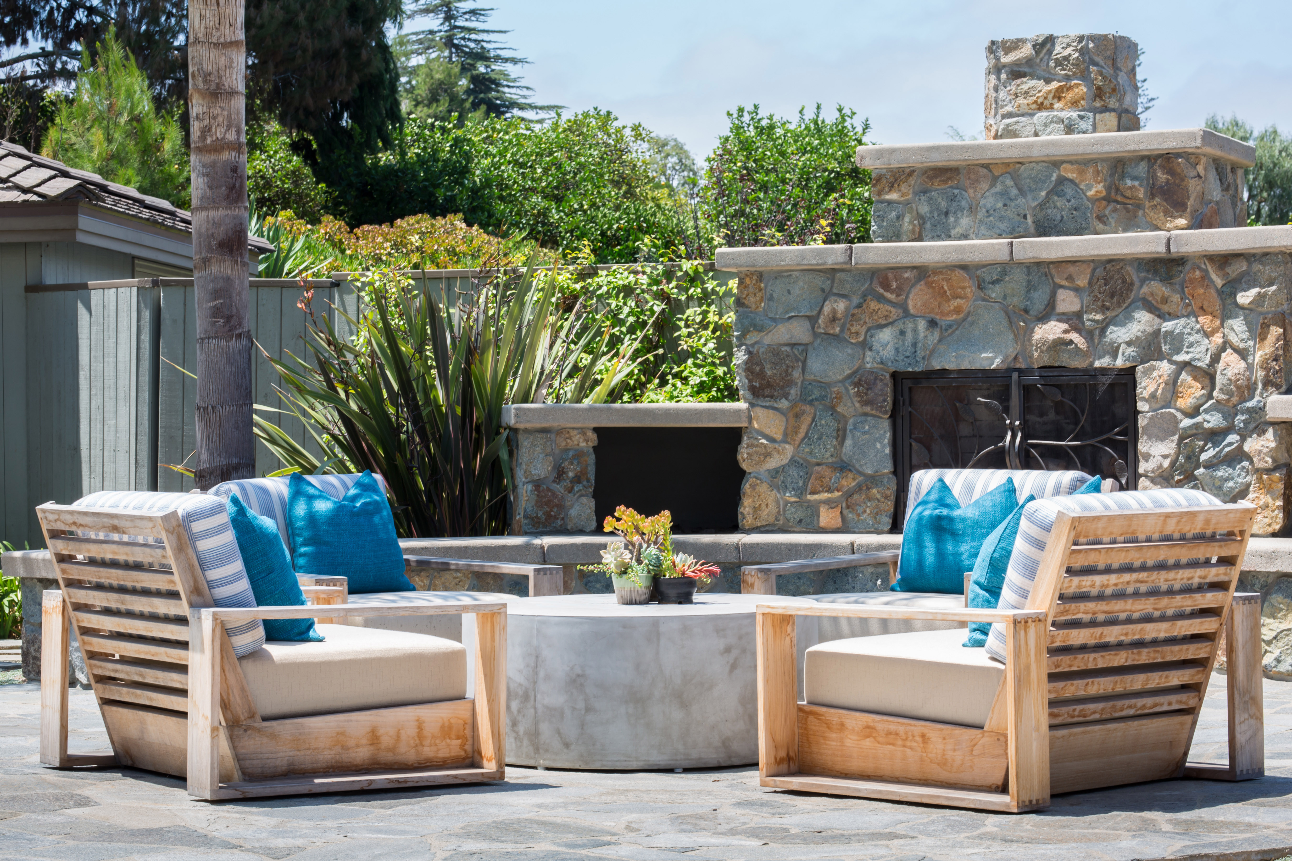 Outdoor Living Room with Stone Fireplace