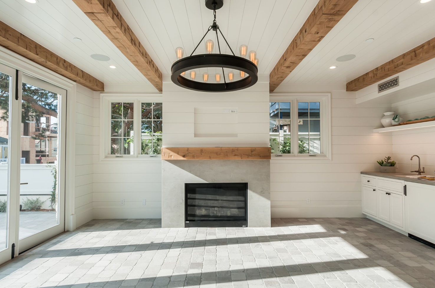 When working in a monochromatic palette, the ceiling is a great place to add some visual interest, drawing the eye up. Beams, shiplap, and custom millwork subtly define this home's coastal farmhouse style.