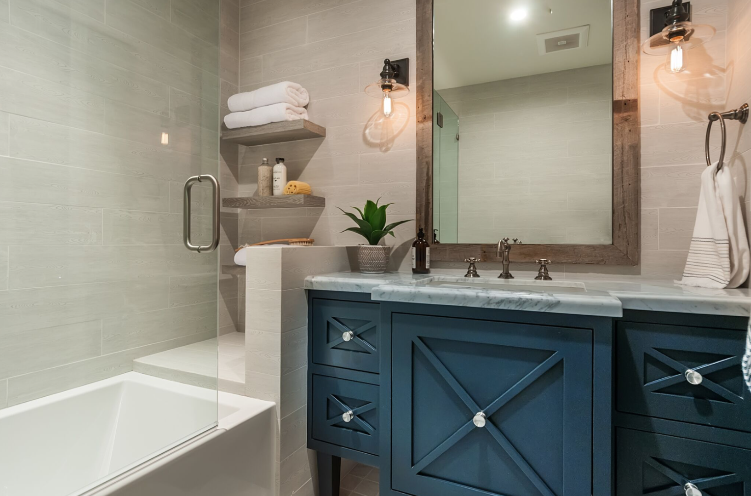 Throughout this home, the lighting & hardware in bathrooms accents the industrial design, an intrinsic feature of the modern farmhouse.