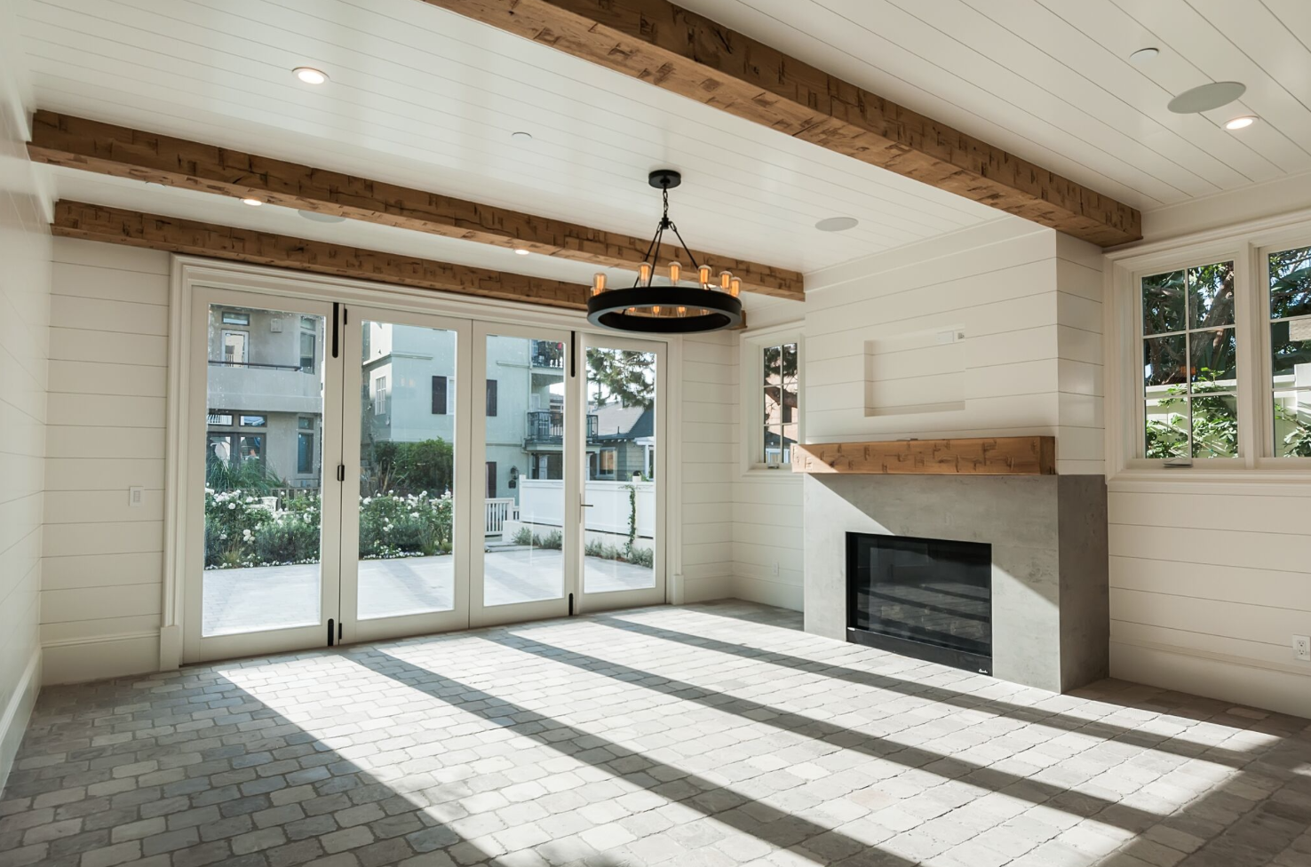 Fireplaces are these giant holes in walls that provide great design opportunity! In this home, we kept them clean and modern. They're extremely durable; made of cement, stone, and wood. They're focal points that combine materials in a modern way, a motif that runs throughout the home.