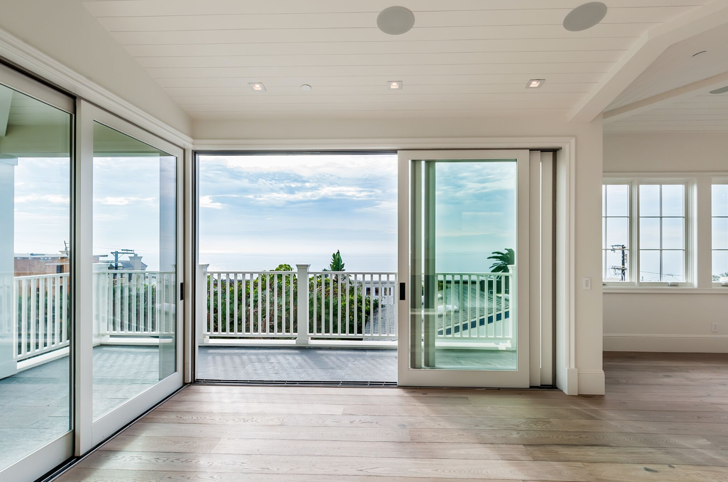 Living at the beach is all about highlighting those fabulous coastal views! The windows and doors throughout this home are giant, floor to ceiling and easily slide to create the home's seamless design from indoor to out. Remember: Keep it subtle. You never want design to compete with an incredible view.