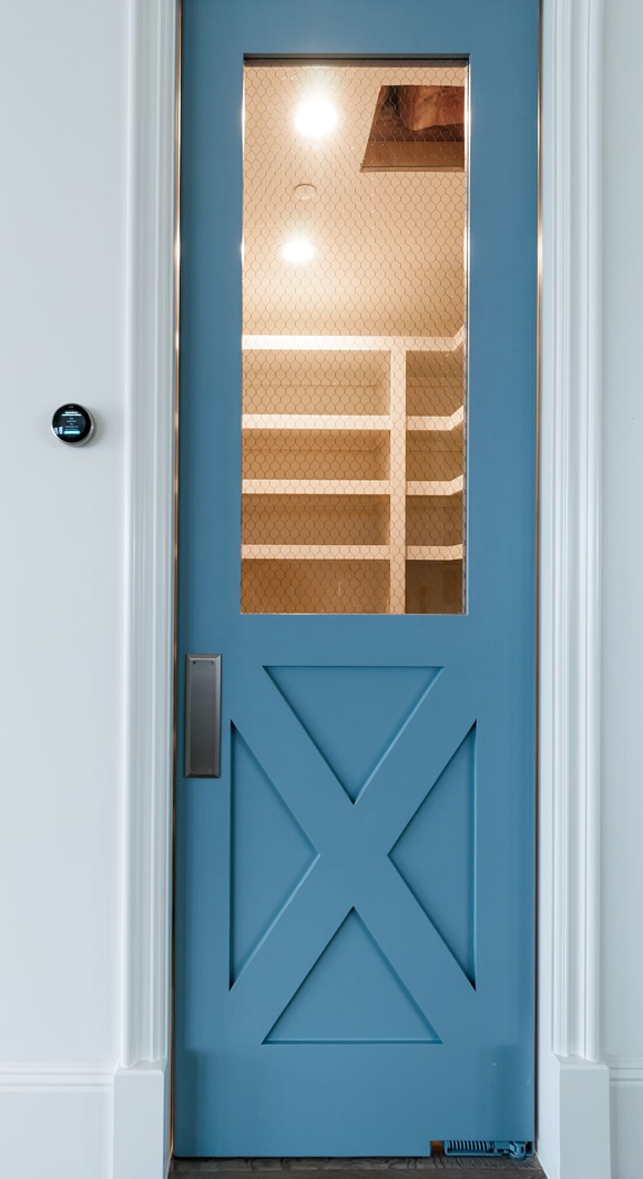Farmhouse style front and side doors really drove the theme home without being too obvious. Blue doors.