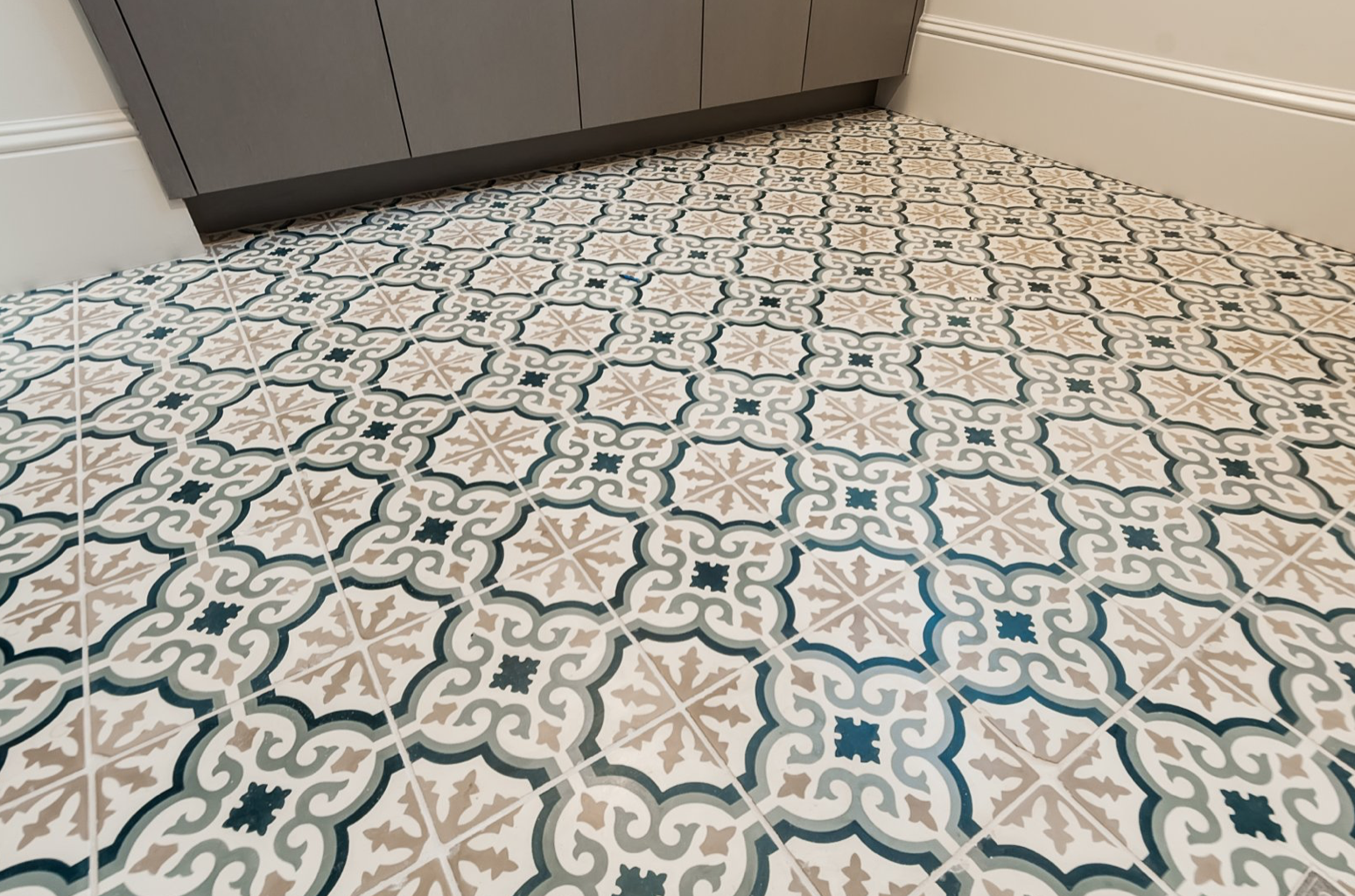 ceramic mosaic tile flooring in modern coastal farmhouse bathroom