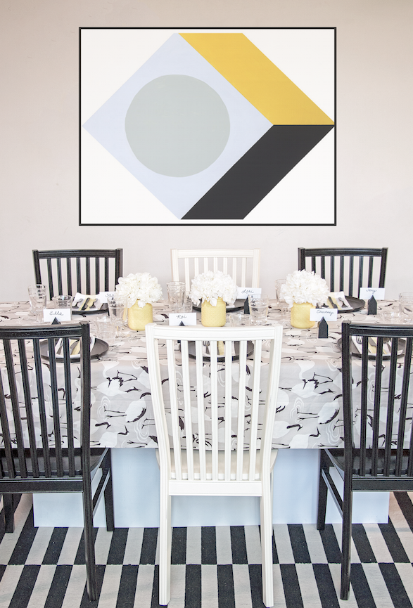 Sunny modern dining room in black and white with calico corners tablecloth