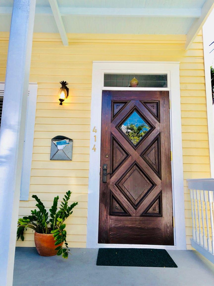 Yellow Key West Cottage with Wooden Door