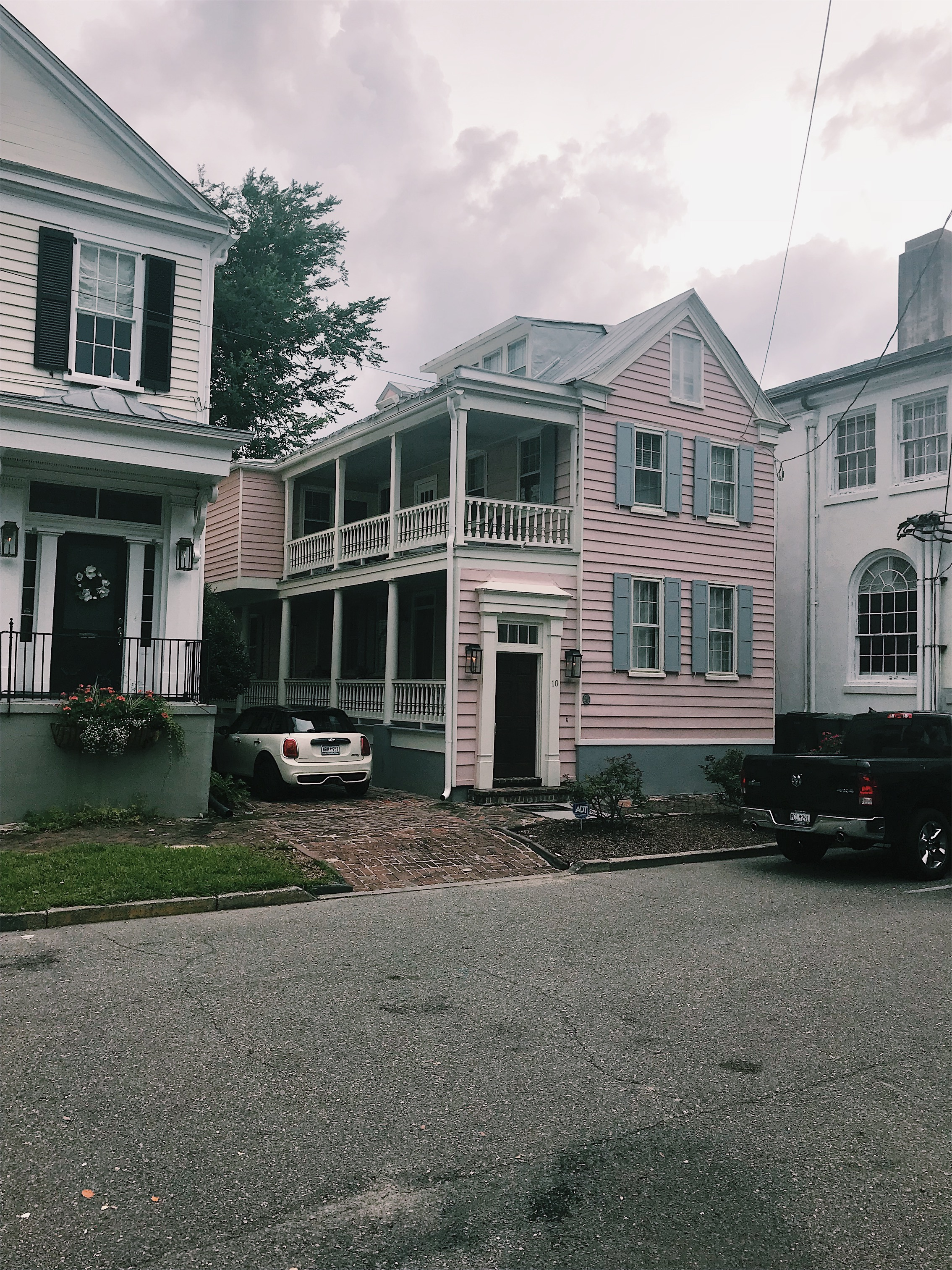 pink house with blue shutters