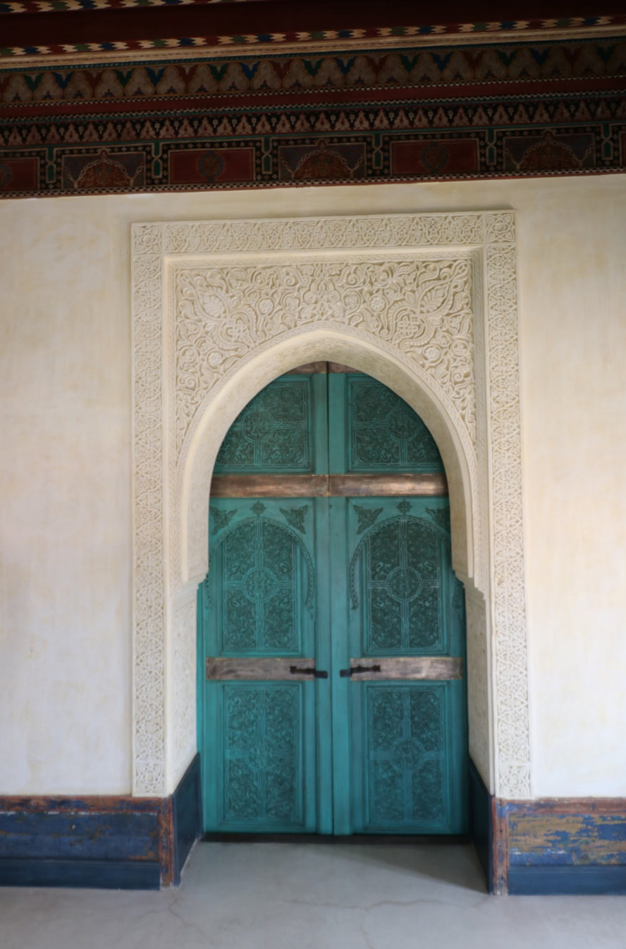 arched doorway with teal door in Morocco