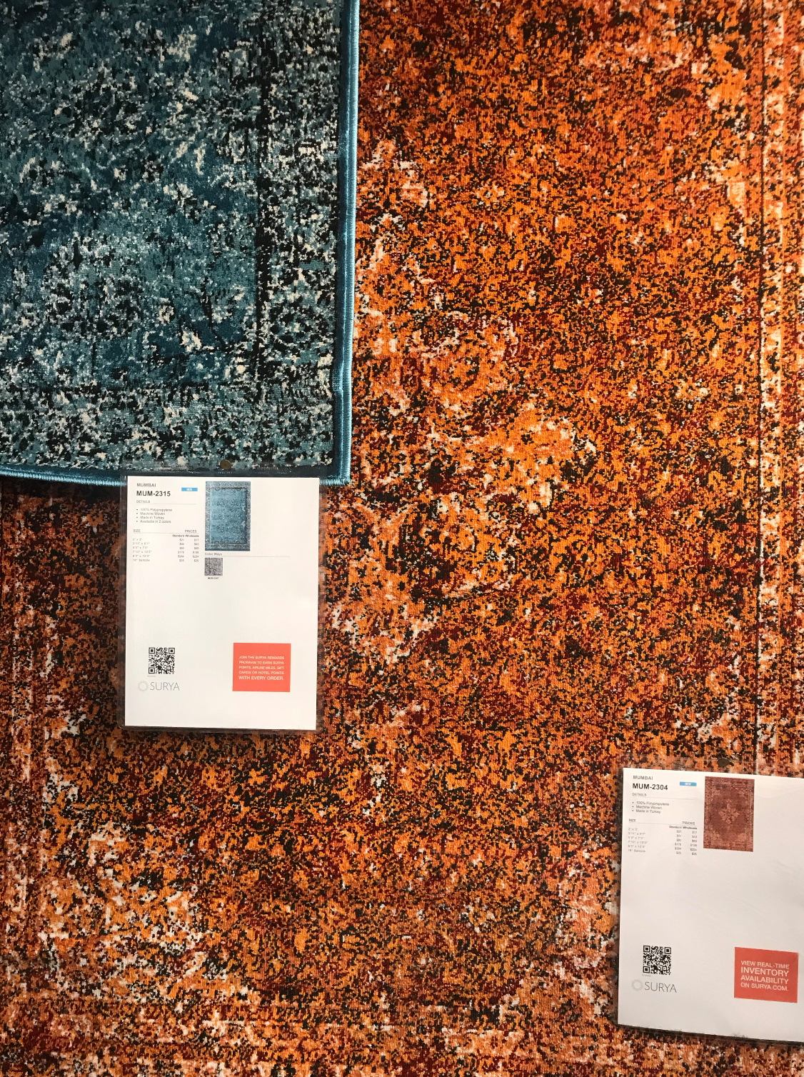 teal and orange flat weaves from Surya rugs