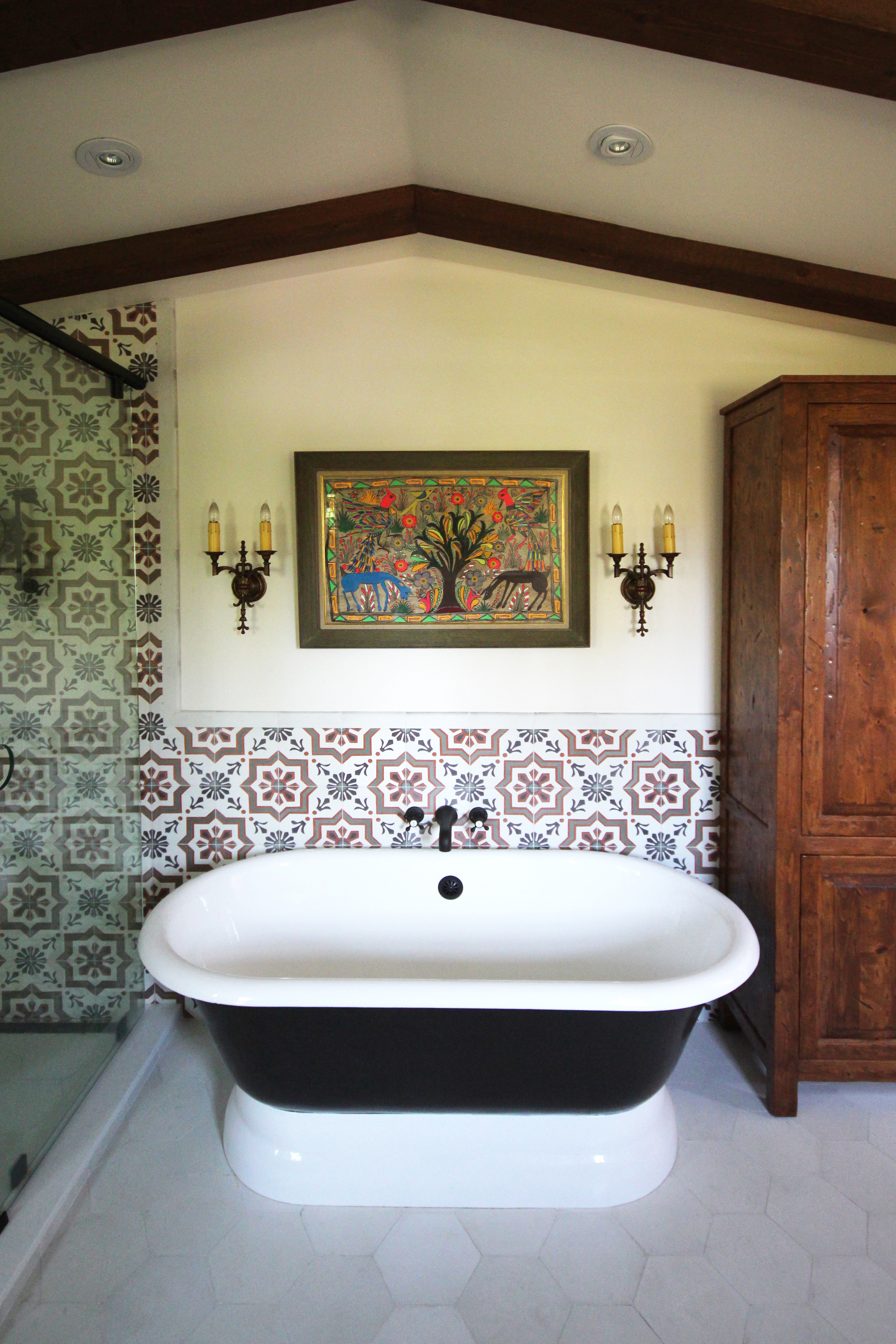Mediterranean Bath with Tile Wall