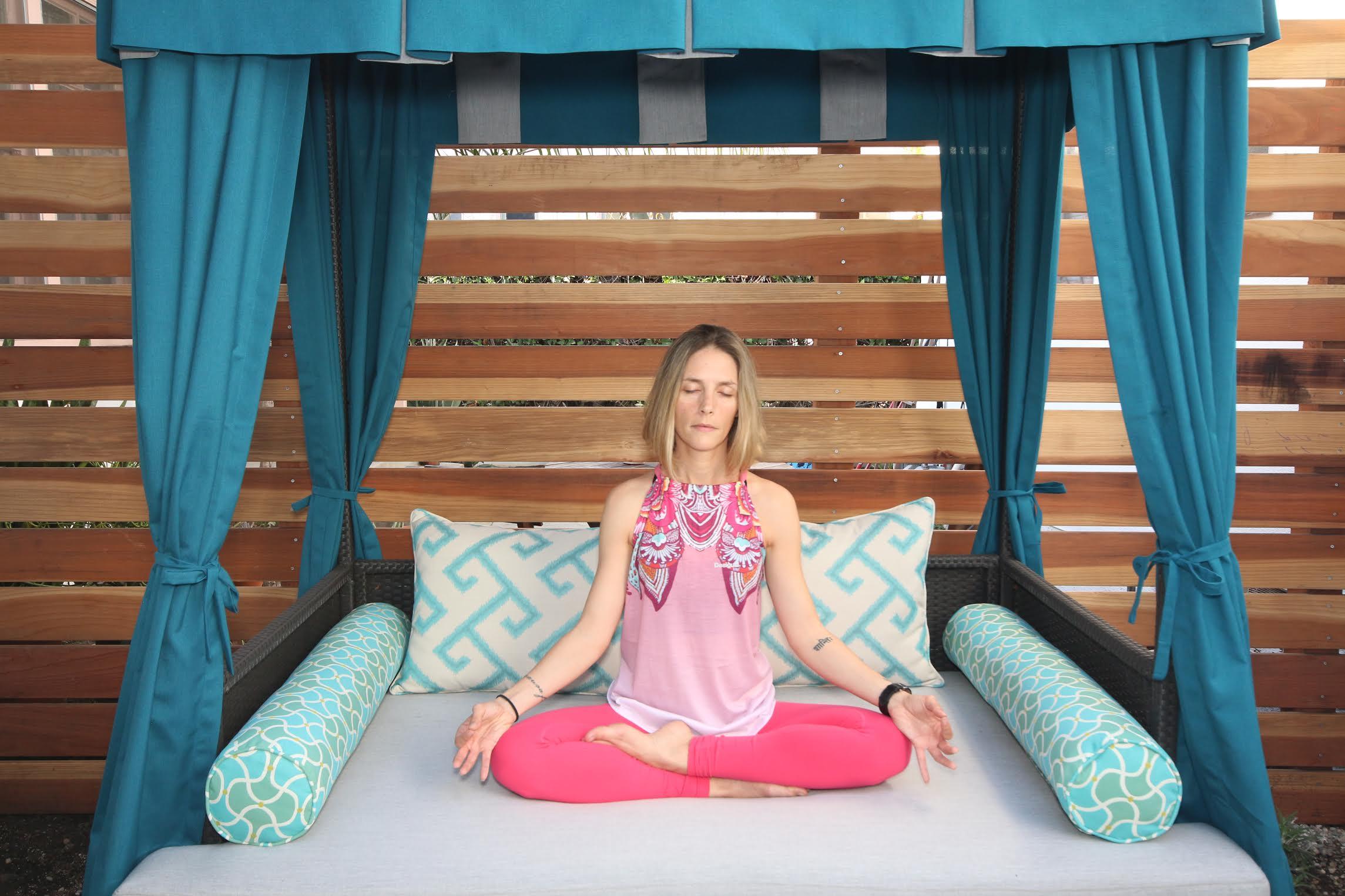 outdoor meditation lounge with yogi on meditation bed